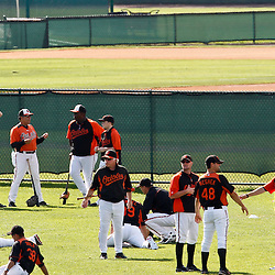 March 20, 2012; Sarasota, FL, USA; Baltimore Orioles manager Buck Showalter (26) with his team during stretch exercises  on a field behind the stadium before a spring training game against the Philadelphia Phillies at Ed Smith Stadium.  Mandatory Credit: Derick E. Hingle-US PRESSWIRE