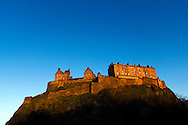 Edinburgh Castle in warm evening sunlight.