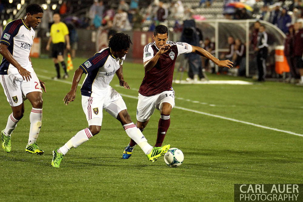 August 3rd, 2013 - Colorado Rapids midfielder Tony Cascio (14) attempts to bring the ball down past Real Salt Lake midfielder Lovel Palmer (7) in second half action of the Major League Soccer match between Real Salt Lake and the Colorado Rapids at Dick's Sporting Goods Park in Commerce City, CO