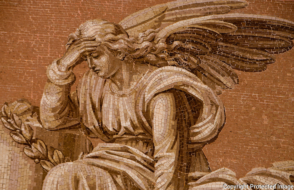 Close-up of a stone mosaic of a sad angel at Isola San Michel in Venice, Italy.