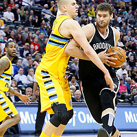 04 March 2016: Brooklyn Nets center Brook Lopez (11) drives past Denver Nuggets center Nikola Jokic (15) during the Brooklyn Nets 121-120 victory over the Denver Nuggets, at the Pepsi Center, Denver, Colorado, USA.