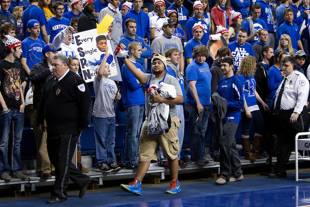 Stephen Hardy, right, and Tyler Holman, center, are escorted out of Rupp Arena after being inappropriate during a ESPN Gameday broadcast from Rupp Arena before the Missouri vs. Kentucky game, Saturday, Feb. 23, 2013 in Lexington.