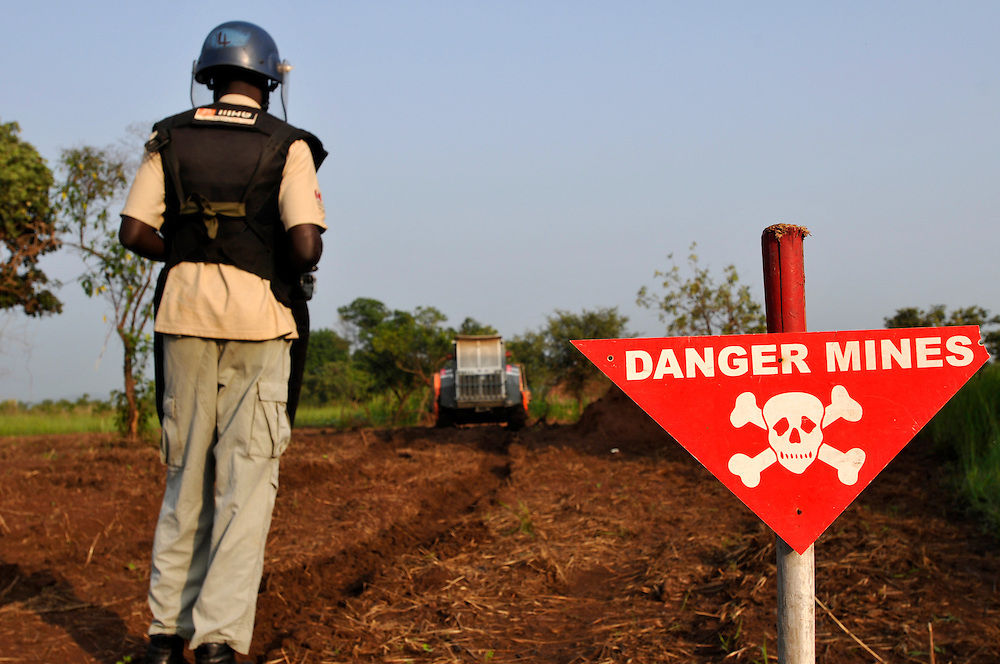 A mechanical demining team from Mines Advisory Group (MAG) using a Bozena mechanical asset and manual clearance working in an area contaminated with landmines and unexploded ordinance that is greatly needed for agricultural production..Kimba, South Sudan. 25/06/2011..Photo © J.B. Russell