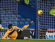 Leeds United goalkeeper Marco Silvestri is beaten from the penalty spot by Brighton striker Tomer Hemed during the Sky Bet Championship match between Brighton and Hove Albion and Leeds United at the American Express Community Stadium, Brighton and Hove, England on 29 February 2016. Photo by Bennett Dean.