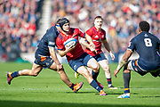 Tyler Bleyendaal (#22) of Munster Rugby looks to sidestep Viliame Mata (#8) of Edinburgh Rugby during the Heineken Champions Cup quarter-final match between Edinburgh Rugby and Munster Rugby at BT Murrayfield Stadium, Edinburgh, Scotland on 30 March 2019.