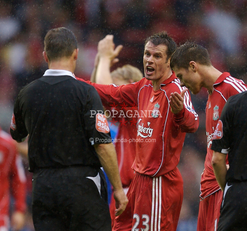 Liverpool, England - Sunday, August 19, 2007: Liverpool's Jamie Carragher questions referee Rob Styles at the end of the 1-1 draw with Chelsea  after the Premiership match at Anfield. (Photo by David Rawcliffe/Propaganda)