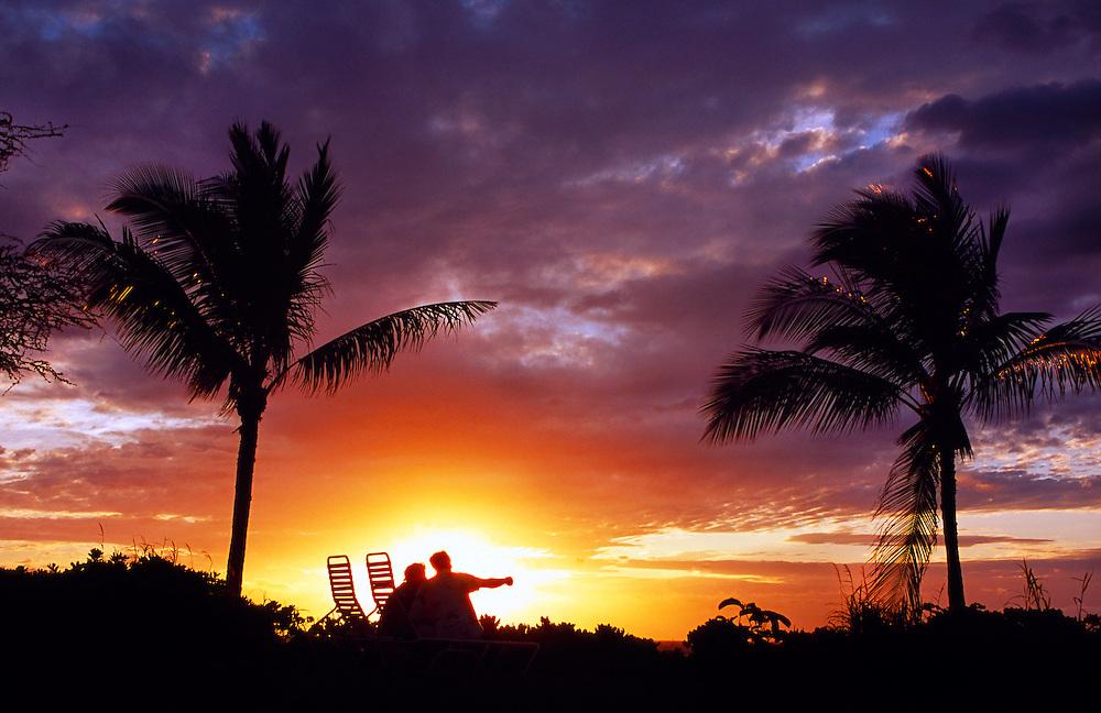 Couple watching sunset, Maul'aka Beach, Makena, Maui, Hawaii