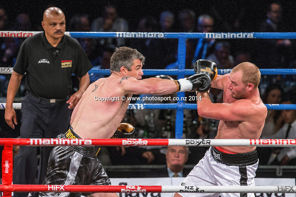 Brad `Hollywood` Pitt (L) fights Daniel Ammann in the Mahindra Super 8 Fight Night, North Shore Events Centre, Auckland, New Zealand, Saturday, November 22, 2014. Photo: David Rowland/Photosport