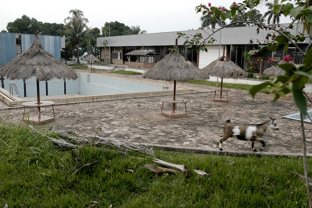 The empty pool on the grounds of the Nzekele Hotel. The hotel complex was built by Mobutu Sese Seko, and is still owned by his family, in his native village in Equateur province. The hotel and town were looted by rebel forces during the country's civil war..Gbadolite, DR Congo. 18/03/2009..Photo © J.B. Russell