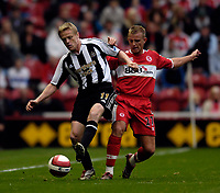 Photo: Jed Wee.<br /> Middlesbrough v Newcastle United. The Barclays Premiership. 22/10/2006.<br /> <br /> Middlesbrough's Lee Cattermole (R) tries to tackle Newcastle's Damien Duff.