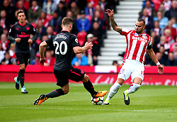 (Caption Correction) Jese of Stoke City tackles Shkodran Mustafi of Arsenal - Mandatory by-line: Robbie Stephenson/JMP - 19/08/2017 - FOOTBALL - Bet365 Stadium - Stoke-on-Trent, England - Stoke City v Arsenal - Premier League