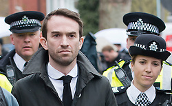 © London News Pictures. 23/04/2012. Feltham, UK. Trenton Oldfield leaving Feltham Magistrates' Court in West London, by police escort where he faced charges under the Public Order Act after he allegedly swam out into the Thames during the The boat race between Oxford and Cambridge. The incident forced the boats to stop and re-start from the halfway point. Photo credit : Ben Cawthra /LNP