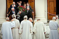 JEROME A. POLLOS/Press...Priests watch as pallbearers carry the casket of Harry Magnuson down the steps of the St. Aloysius Catholic Church in Spokane following services Thursday. Magnuson, known for his fervor for historic preservation, helped preeserve the Wallace Norterhn Pacific Depot, restored the Cataldo Mission and fought to elevate Interstate-90 over Wallace.