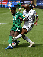 Football - 2019 / 2020 Championship - Swansea City vs Sheffield Wednesday<br /> <br /> André Ayew of Swansea City tackled by Dominic Iorfa of Sheffield Wednesday<br /> in a match played with no crowd due to Covid 19 coronavirus emergency regulations, at the almost empty Liberty Stadium.<br /> <br /> COLORSPORT/WINSTON BYNORTH