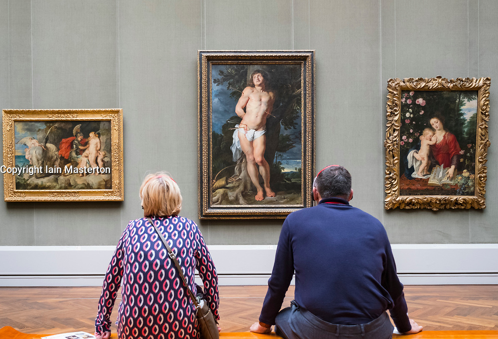 Couple looking at painting by Peter Paul Reubens , Der hl Sebastian at Gemaldegalerie in Berlin, Germany