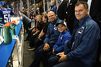 KELOWNA, BC - SEPTEMBER 29: A young fan sits on the bench with Vancouver Canucks' staff during warm up against the Arizona Coyotes at Prospera Place on September 29, 2018 in Kelowna, Canada. (Photo by Marissa Baecker/NHLI via Getty Images)  *** Local Caption ***