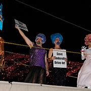 "The Denver-based drag queen troupe known as the Demented Divas is playing fairy godmother and taking the fight to save a local drive-in theater.  The burly belles will perform a version of Cinderella on the roof of the Cinderella Twin Drive-In Movie Theater's concession stand to raise awareness and protest the demolition of south Denver's last drive-in...""We are doing this protest because Denver hardly needs another set of luxury apartments,"" says Nuclia Waste, who will be starring as Cinderella. ""It's ridiculous. Drive-in movie theaters are such an American institution, right up there with apple pie, baseball and Mom. They need to be preserved, not torn down.""  ""We are very sad at the eminent destruction of one of the few remaining drive-in movie theaters in the country,"" says Jim Goble, manager of the drive-in. ""We are happy that the Demented Divas are just as upset about this and want to stage this protest."""