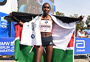 Gladys Cherono (KEN) poses with Kenyan flag after winning the women's race in a course record 2:18.11 during the 45th Berlin Marathon in Berlin, Germany, Sunday, Sept. 16, 2018.. (Jiro Mochizuki/Image of Sport)