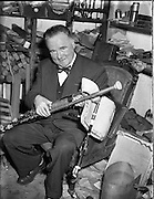 Leo Rowsome making pipes at 9 Belton Park Road.16/06/56 uilleann pipes,