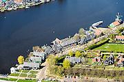 Nederland, Noord-Holland, Zaandstad, 20-04-2015; Kalverpolder, Zaanse Schans, openlucht museum met historische houten huizen, winkels, werkplaatsen oude ambachten en molens aan oevers van rivier de Zaan.<br /> Outdoor museum Zaanse Schans, historic windmills, workshops and houses. <br /> luchtfoto (toeslag op standard tarieven);<br /> aerial photo (additional fee required);<br /> copyright foto/photo Siebe Swart