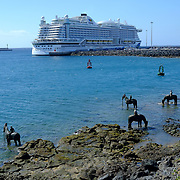 A cruise boat is seen in Arrecife  with horses sculptures in the foreground. Lanzarote on 23/03/2018