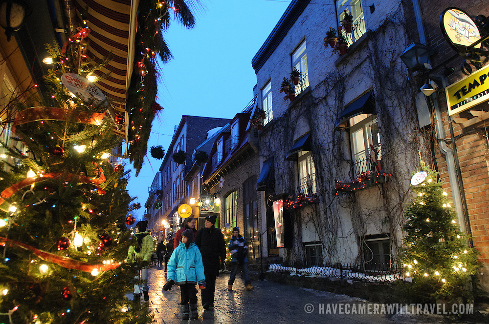 The quaint old shopping street of Rue du Petit-Champlain in Quebec City's Old Town, decorated for Christmas and taken at night.