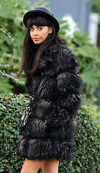 TV Presenter Jameela Jamil, wearing a fur coat, knee high socks and boots was out and about with a male friend in north London. UK. 21/01/2012<br />BYLINE MUST READ : GOTCHAIMAGES.COM<br /><br />Copyright by © Gotcha Images Ltd. All rights reserved.<br />Usage of this image is conditional upon the acceptance <br />of Gotcha Images Ltd, terms and conditions available at<br />www.gotchaimages.com