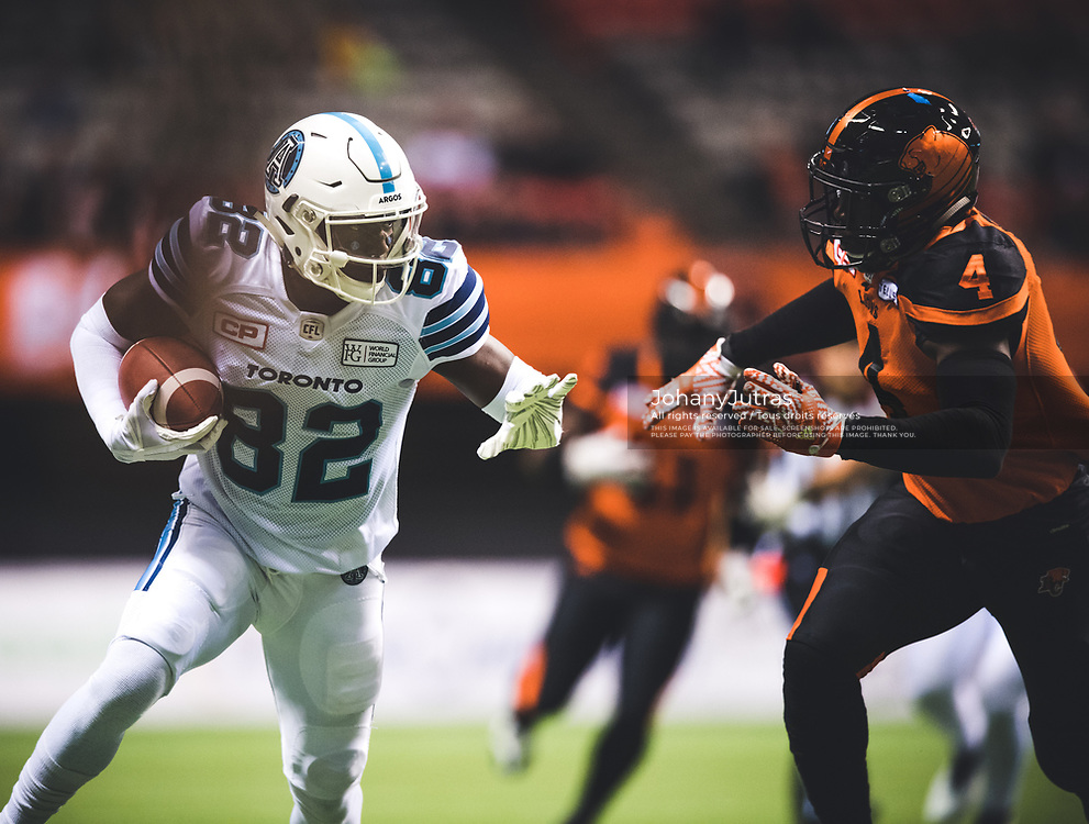 Malcom Williams (82) of the Toronto Argonauts and Alex Bazzie (4) of the BC Lions during the game at BC Place Stadium in Vancouver, BC, Saturday Nov. 4, 2017. (Photo: Johany Jutras)