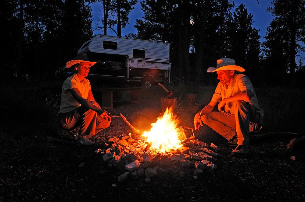 Camper on Custer National Forest Campground, evening Bonfire, near Ashland,  Montana, USA