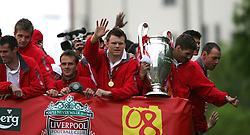 LIVERPOOL, ENGLAND - THURSDAY, MAY 26th, 2005: Liverpool's John Arne Riise and Steven Gerrard parade the European Champions Cup on on open-top bus tour of Liverpool in front of 500,000 fans after beating AC Milan in the UEFA Champions League Final at the Ataturk Olympic Stadium, Istanbul. (Pic by David Rawcliffe/Propaganda)