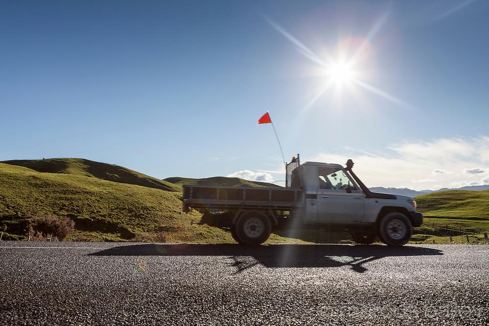 Ute on rural road, Waikato, New Zealand