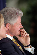 US President Bill Clinton listens during a ceremony on the South Lawn of the White House September 11, 1998 in Washington, DC. Clinton received the Paul O'Dwyer Peace and Justice Award for Clinton's work in helping bring peace in Northern Ireland. The ceremony took place the same day the Starr Report was released to Congress.