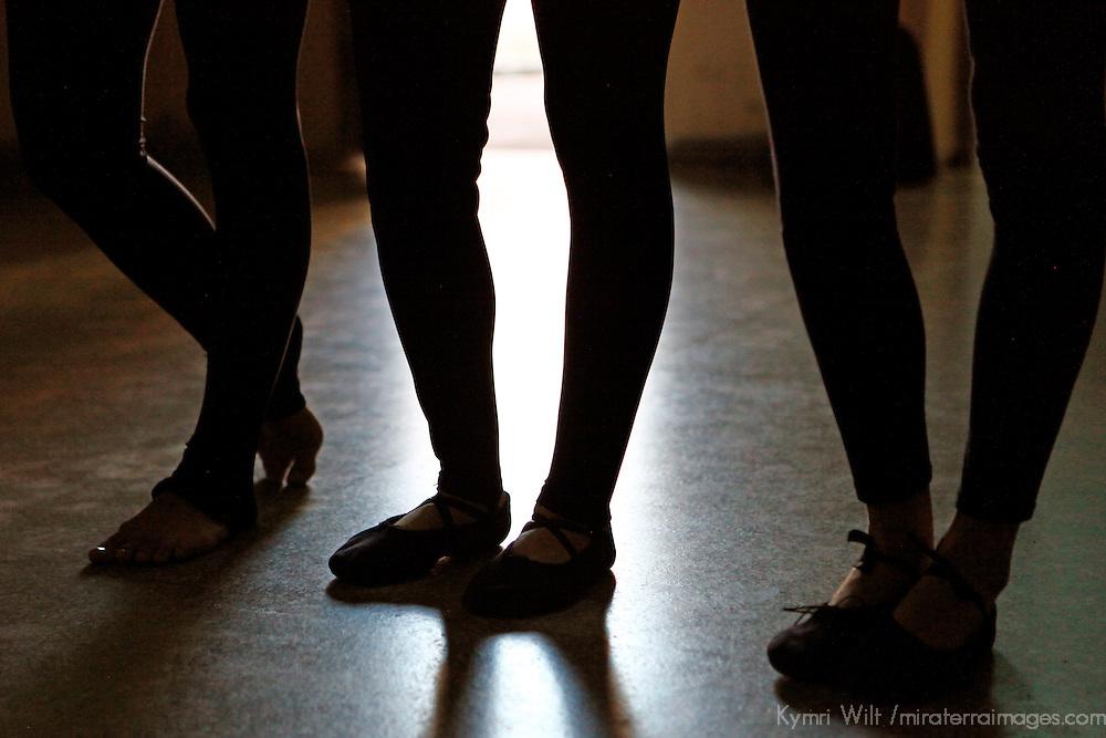 Central America, Cuba, Santa Clara. Dancer's legs in silhouette at the Santa Clara Musical School of Art, Cuba.