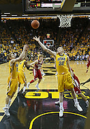 January 19 2013: Iowa Hawkeyes guard Mike Gesell (10) and Iowa Hawkeyes forward Aaron White (30) look to pull in a rebound during the first half of the NCAA basketball game between the Wisconsin Badgers and the Iowa Hawkeyes at Carver-Hawkeye Arena in Iowa City, Iowa on Sautrday January 19 2013. Iowa defeated Wisconsin 70-66.