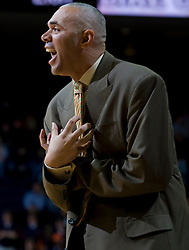 Virginia head coach Dave Leitao instructs one of his players on defense.  The Virginia Cavaliers men's basketball team defeated the Elon Phoenix 91-61  at the John Paul Jones Arena in Charlottesville, VA on December 22, 2007.