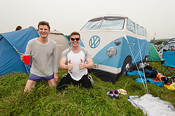 © Licensed to London News Pictures. 05/09/2014. Isle of Wight, UK. Festival goers at Bestival 2014 Day 2 Friday sit alongside their VW camper van tent.  This weekend's headliners include Chic featuring Nile Rodgers, Foals and Outcast Photo credit : Richard Isaac/LNP