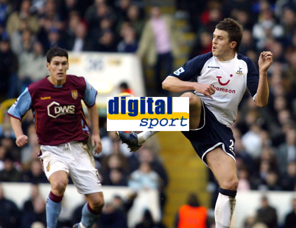 Photo: Chris Ratcliffe.<br />Tottenham Hotspur v Aston Villa. The Barclays Premiership. 21/01/2006.<br />Michael Carrick (R) of Spurs helps the ball on its way as Gareth Barry watches on.