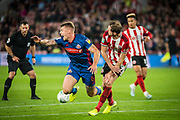 Max Power of Sunderland FC is challenged in the Sheffield United's penalty area during the EFL Cup match between Sheffield United and Sunderland at Bramall Lane, Sheffield, England on 25 September 2019.