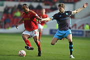 Nottingham Forest striker Chris O'Grady holds off Sheffield Wednesday defender Glenn Loovens during the Sky Bet Championship match between Nottingham Forest and Sheffield Wednesday at the City Ground, Nottingham, England on 12 March 2016. Photo by Jon Hobley.
