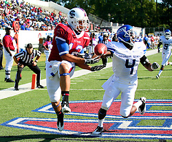 South Carolina State University's Thomas Williams looks for the ball against Georgia State's Demazio Skelton Saturday at SCSU in Orangeburg.