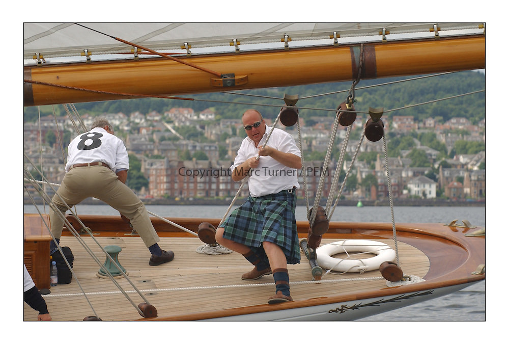 Moonbeam's crew dressed in kilts on the Tuesday morning and paraded around the entrance to the Gareloch off Rhu...This the largest gathering of classic yachts designed by William Fife returned to their birth place on the Clyde to participate in the 2nd Fife Regatta. 22 Yachts from around the world participated in the event which honoured the skills of Yacht Designer Wm Fife, and his yard in Fairlie, Scotland...Marc Turner / PFM Pictures