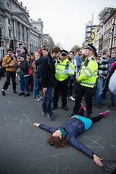 London, UK. 17th April 2019. Police officers prepare to arrest climate change activists from Extinction Rebellion in Parliament Square as part of an operation to try to clear protesters taking part in the International Rebellion in order to reopen the square to traffic.