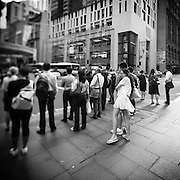 People waiting on street corners in Sydney, Australia