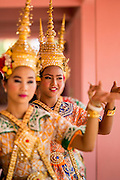 "29 SEPTEMBER 2012 - NAKORN NAYOK, THAILAND:  Thai dancers perform during observances of Ganesh Ustav at Wat Utthayan Ganesh, a temple dedicated to Ganesh in Nakorn Nayok, about three hours from Bangkok. Many Thai Buddhists incorporate Hindu elements, including worship of Ganesh into their spiritual life. Ganesha Chaturthi also known as Vinayaka Chaturthi, is the Hindu festival celebrated on the day of the re-birth of Lord Ganesha, the son of Shiva and Parvati. The festival, also known as Ganeshotsav (""festival of Ganesha"") is observed in the Hindu calendar month of Bhaadrapada, starting on the the fourth day of the waxing moon. The festival lasts for 10 days, ending on the fourteenth day of the waxing moon. Outside India, it is celebrated widely in Nepal and by Hindus in the United States, Canada, Mauritius, Singapore, Thailand, Cambodia, Burma , Fiji and Trinidad & Tobago.     PHOTO BY JACK KURTZ"