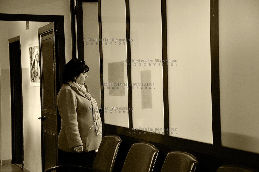 Palermo, headquarters of Emergency: woman migrated from East Europe waiting for the doctors.<br /> Palermo, locali dell'ambulatorio di Emergency: donna originaria dell'Europa dell'est in attesa di essere visitata dai dottori.