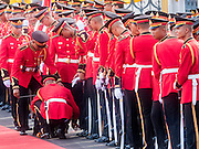 23 JULY 2015 - BANGKOK, THAILAND:  Thai soldier shine their shoes before the arrival ceremony for the Vietnamese Prime Minister at Government House in Bangkok. The Vietnamese Prime Minister and his wife came to Bangkok for the 3rd Thailand - Vietnam Joint Cabinet Retreat. The Thai and Vietnamese Prime Minister discussed issues of mutual interest.     PHOTO BY JACK KURTZ