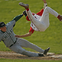South Salem's Derek Adent flies through the air after running into McKay's Jeff Martin during the Saxons' 7-2 victory in a Central Valley Conference game at Gilmore Field on Friday, May, 2, 2008.  Photo by Timothy J. Gonzalez