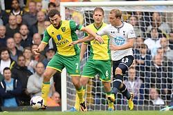 Norwich's Robert Snodgrass and Tottenham's Christian Eriksen compete for the ball  - Photo mandatory by-line: Mitchell Gunn/JMP - Tel: Mobile: 07966 386802 14/09/2013 - SPORT - FOOTBALL -  White Hart Lane - London - Tottenham Hotspur v Norwich - Barclays Premier League