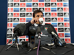 GLASGOW, SCOTLAND - Thursday, March 21, 2013: Wales' manager Chris Coleman drinks a cup of coffee during a press conference at Hampden Park ahead of the 2014 FIFA World Cup Brazil Qualifying Group A match against Scotland. (Pic by David Rawcliffe/Propaganda)