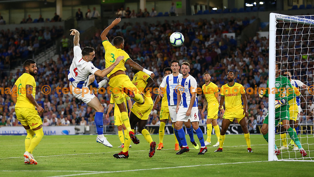 Diego Carlos of FC Nantes challenges Shane Duffy of Brighton during the pre season friendly between Brighton and Hove Albion and FC Nantes at the American Express Community Stadium in Brighton. 03 Aug 2018